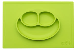 EZPZ Happy Mat shown in lime green, with food, silicone placement and plate all in one