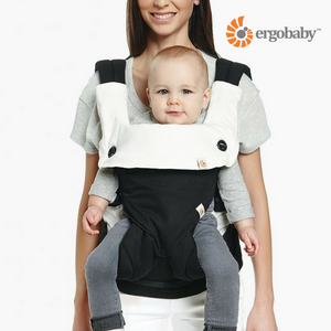 baby in the ergobaby 360 carrier with the ergobaby drool pad and bib in 100% cotton