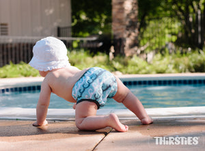 Thirsties Swim Diaper on baby, poolside, with mom, made in the usa