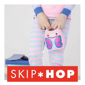 Skip Hop Zoo Nightlight in butterfly, shown with child holding, ready for bed