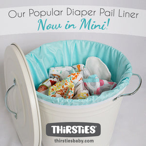 Thirsties Mini Diaper Pail Liner in Aqua in the diaper pail with the Thirsties logo