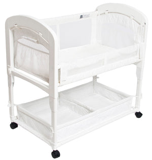 natural colored arm's reach cambria co-sleeper and bassinet has beautiful wooden ends