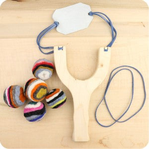 Handmade wooden slingshot with five felt balls, made in the usa by Camden Rose