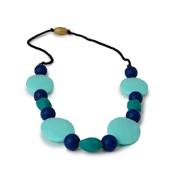 chewbeads tribeca necklace in turquoise features three different sizes and colored bead, 100%silicone teething jewelry