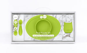 ezpz first food set in lime green includes; fork and spoon, tiny cup and tiny bowl mat