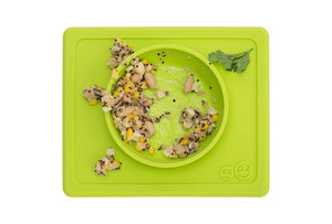ezpz mini mat all in one bowl and placemat in lime with food before meal time