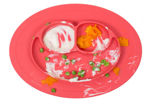 coral ezpz all in one mini mat that suctions to a table or highchair with food in the 3 compartments before mealtime