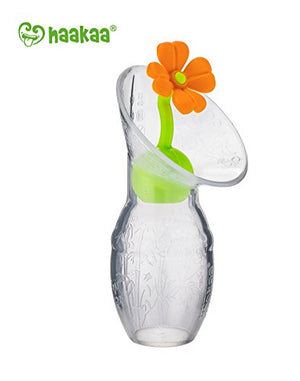Haakaa Silicone Breast Pump Flower Stopper with orange flower and green stopper base