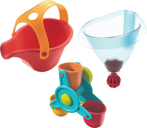Packaging for the Haba Bathing Bliss Water Wonders bath toy, red watering can, water wheel with 3 colorful buckets, and a funnel