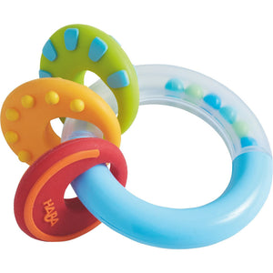 "HABA Nobbi Clutching toy is red, yellow, green and blue and measure 3.5"" in diameter"