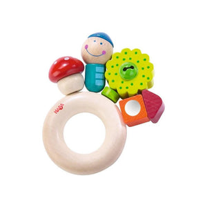 Haba Pixie Clutching Toy, wooden ring with mushroom, house, flower, and person on top