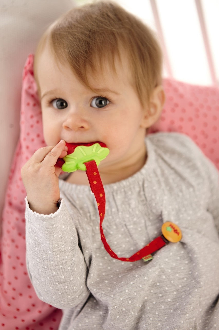 Haba Strawberry Clutching Toy & Teether is red and green with detachable ends and made from food grade silicone