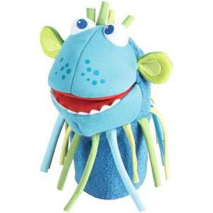 Turquoise blue with a silly smile and a string beard is the HABA Monster Momo Glove Puppet measures 10.5""