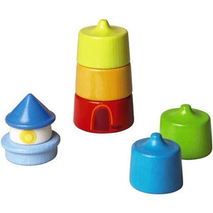 Colorful 8 piece HABA Lighthouse Stacking Game all stacked up to form a lighthouse