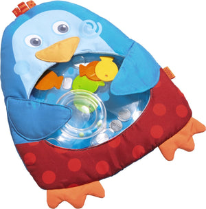 Haba little penguin water play mat measures 13.5 inches in bright blue and red with orange feet