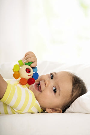HABA Whirlygig wooden rattle and teether, rainbow colors with bell