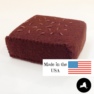 "Close up of made in NY and USA felt brownies that measures 3"" x 2 1/4"" x 1"""