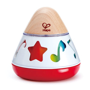 Baby playing with Hape Rotating Music box