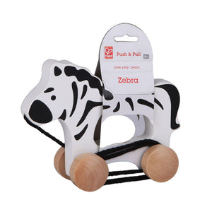 Hape Zebra Push and Pull toy is white with black stripes and wheels in packaging