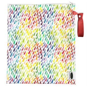 imagine lite wet bag in happy floral print, brilliant primary colored flowers and ferns