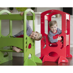 laughing children playing in an apple green and red learning tower from little partners