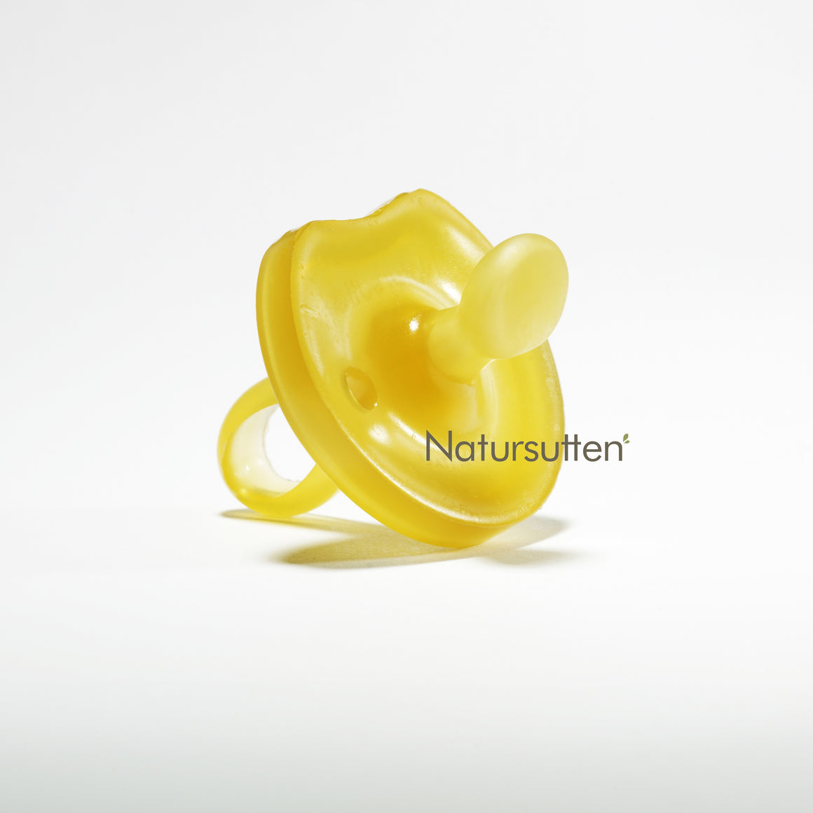 baby using a natursutten pacifier, close up of a pacifier and the Natursutten logo