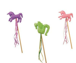 lavender unicorn, pink unicorn, and green dragon on their magical wood wands