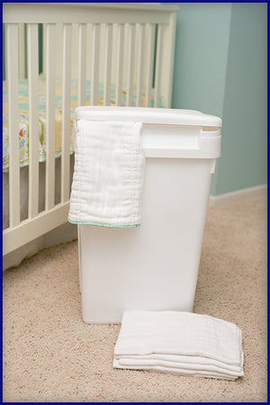 BNI's Original Cloth Diaper Pail, shown with prefolds in nursery