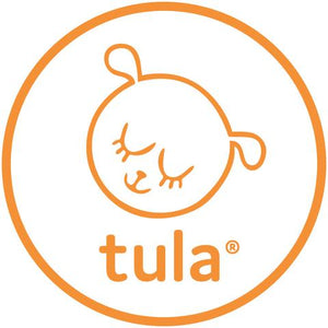 tula explore baby carrier on the front with baby facing out