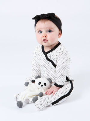 seated baby holding the under the nile panda lovey that measures 9""
