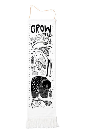 Wee gallery woodland growth chart, black print on white organic canvas measures 44×13 inches