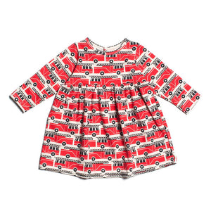 Geneva baby dress with red firetrucks is made from 100% organic cotton and made in the USA