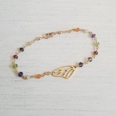 multi gemstone beaded bracelet with butterfly