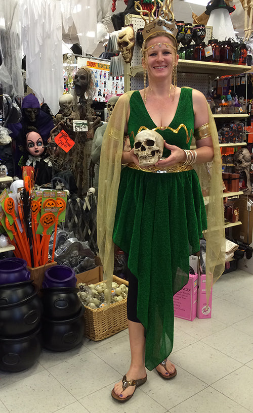Store owner wears comfortable sandals by Vionic as part of her Greek inspired Halloween costume