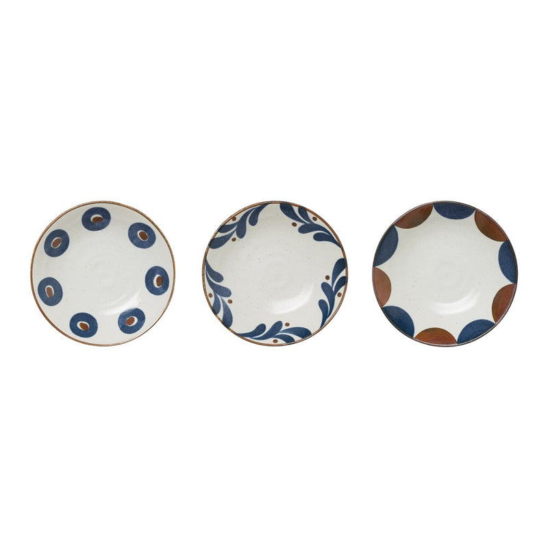 Photograph of three patterned bowls