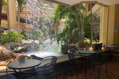 Kai Coffee Hawaii Hyatt Regency exterior with waterfall and cafe tables