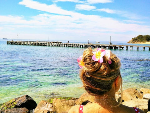Daniela's Dairy: How To Travel Sea Gypsy Style - My Top Travel Tips. Flower hair clips are great for a quick up do and to add some tropical ambiance to any outfit.