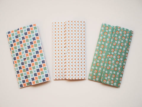 Pastel Nordic design money envelopes in blue and coral shades
