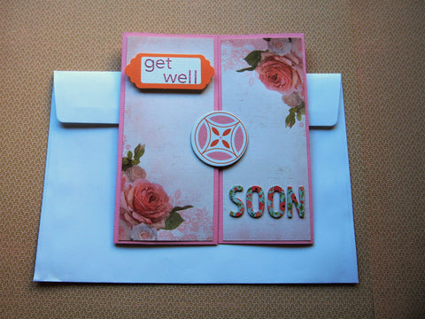 Get Well Soon gatefold card in pink, white and orange with floral decorations
