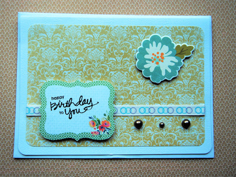Elegant Happy Birthday handmade card with olive green background and floral decorations