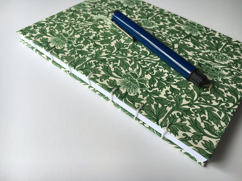 Handmade journals with beautiful exposed coptic stitch binding and blank inner pages