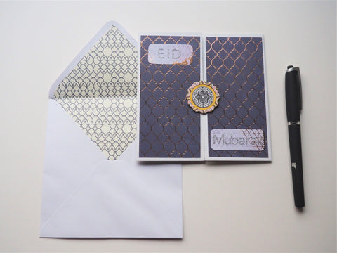 Purple gatefold Eid Mubarak card with gold touches
