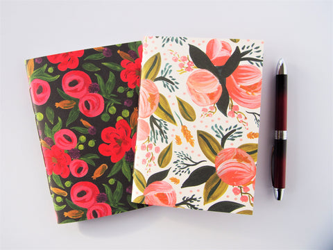 Modern watercolour blooms hand-bound notebooks on white and black--set of 2