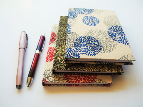 Handbound A6 journals with floral Lokta covers in red, blue or gold | handmade books