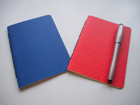 Blue and orange embossed hand-bound notebooks--set of 2