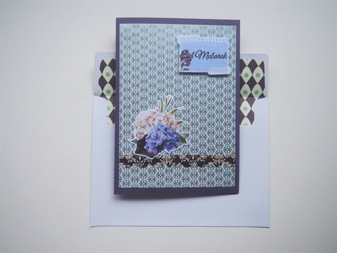Silver Eid Mubarak handmade card on purple with floral detail and matching lined envelope