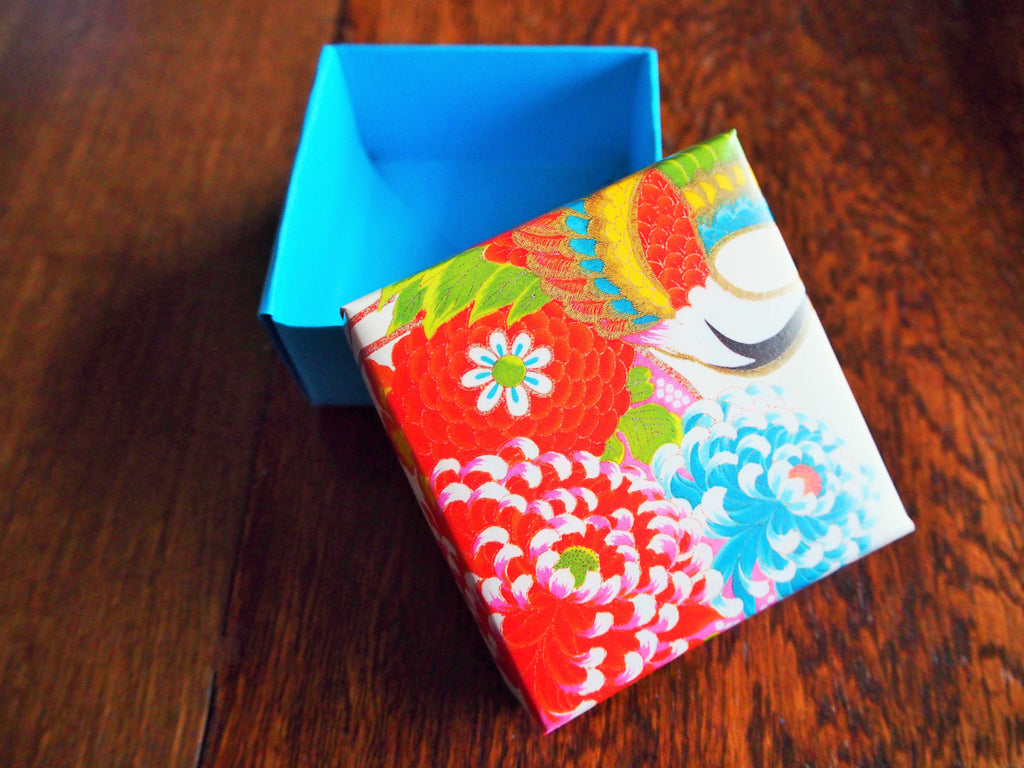 Red and blue floral gift box with lid