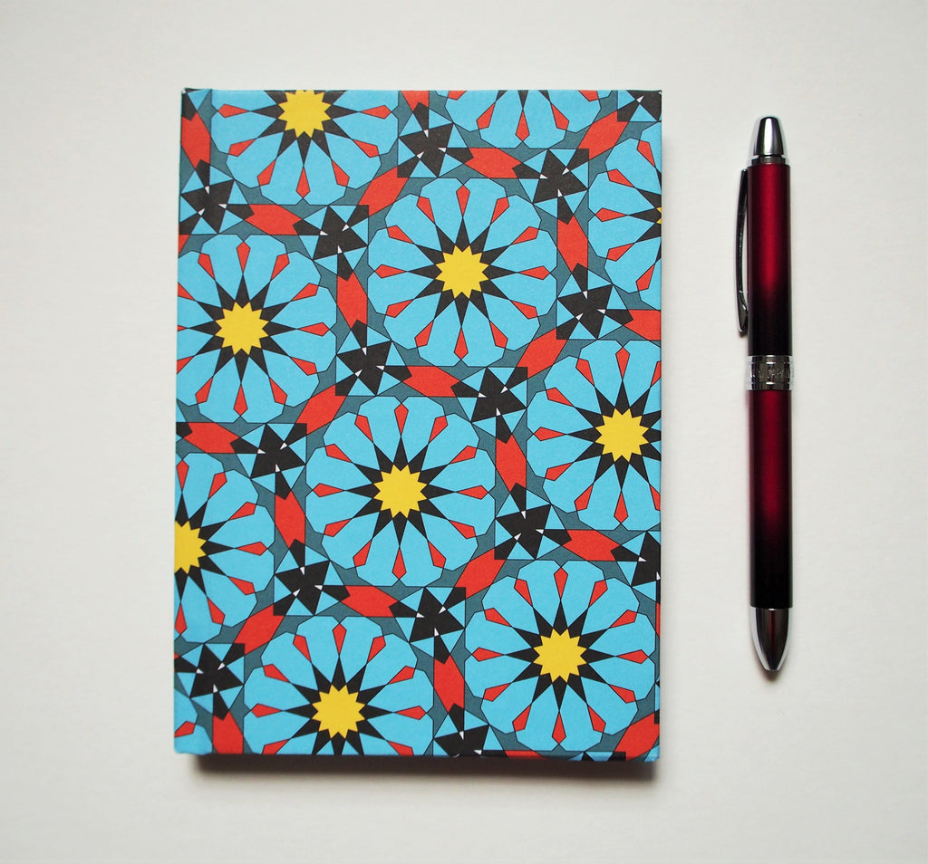 Arabian geometric hand-bound journals in A6 size with coptic stitch binding in 3 colours