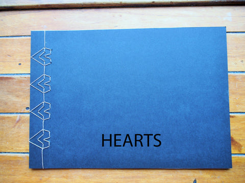 Japanese stab binding notebooks with unique hand-bound decorative designs: Arrows, Hearts, Chevron