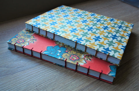 Children's hand-bound travel journal with exclusively designed activity pages in colour and a visible coptic stitch